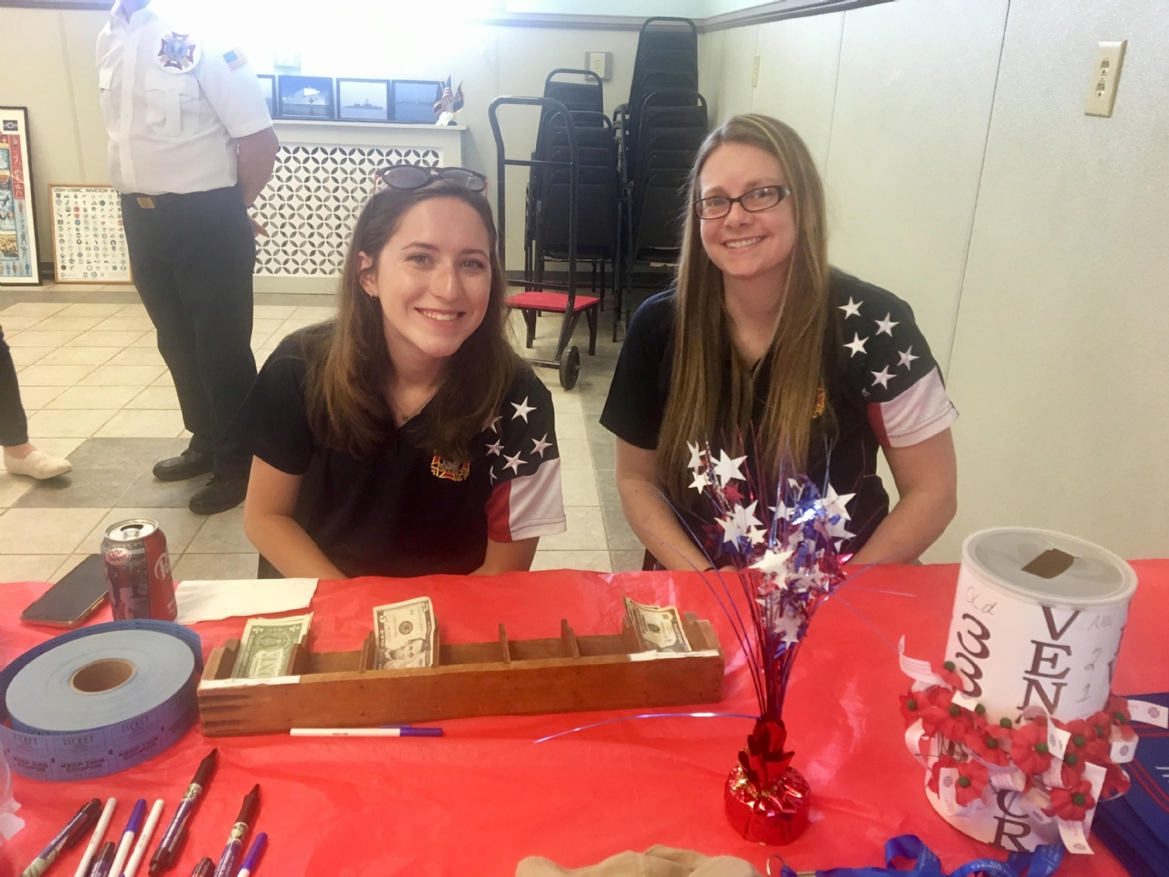 VFW Auxiliary Life Members Jennifer Wagener (R) and Rachel Shulte-Doody distribute Buddy Poppies and handle donations from a larger than usual attendance.